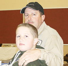 """<div class=""""source""""></div><div class=""""image-desc"""">Ricky Mason and Hunter Mason pose for a picture at the All Pro Dads event at Maurice Bowling Middle School. </div><div class=""""buy-pic""""><a href=""""/photo_select/8883"""">Buy this photo</a></div>"""