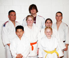 "<div class=""source""></div><div class=""image-desc"">The members of the Owen County judo team recently competed at the University of Tennessee and brought home several first-place awards. Pictured are (from left to right on back row) James Thompson, two first-place awards; Robert Beverly, a second-place fin</div><div class=""buy-pic""><a href=""http://web2.lcni5.com/cgi-bin/c2newbuyphoto.cgi?pub=033&orig=2010-UT-Tournament.jpg"" target=""_new"">Buy this photo</a></div>"