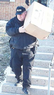 """<div class=""""source"""">Photos by Molly Haines</div><div class=""""image-desc"""">Owenton Police Narcotics Investigator Steve Miller carries the box of processed marijuana delivered to Jackie Gibson from the apartment building located at an 315 North Main Street apartment.</div><div class=""""buy-pic""""><a href=""""http://web2.lcni5.com/cgi-bin/c2newbuyphoto.cgi?pub=033&orig=2_9.jpg"""" target=""""_new"""">Buy this photo</a></div>"""