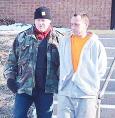 """<div class=""""source"""">Photos by Molly Haines</div><div class=""""image-desc"""">Owenton Police Chief Terry Gentry, right, arrests Jackie Gibson of Sparta who allegedly had eight pounds of processed marijuana delivered to his mother Linda McKinney's apartment.</div><div class=""""buy-pic""""><a href=""""http://web2.lcni5.com/cgi-bin/c2newbuyphoto.cgi?pub=033&orig=3_7.jpg"""" target=""""_new"""">Buy this photo</a></div>"""