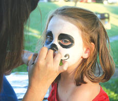 "<div class=""source"">Photo by Mary Alford</div><div class=""image-desc"">Maison Hedger gets her face painted at Fan Fair. </div><div class=""buy-pic""><a href=""/photo_select/9922"">Buy this photo</a></div>"