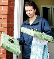 """<div class=""""source"""">Molly Haines </div><div class=""""image-desc"""">Jessica Williams lends a hand to help Owen County kids.</div><div class=""""buy-pic""""><a href=""""/photo_select/8655"""">Buy this photo</a></div>"""