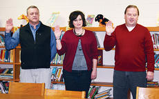 "<div class=""source""></div><div class=""image-desc"">Owen County Board of Education members Dr. Larry Johnson, Kimberly Hunter and Stuart Bowling were given the constitutional oath of office at the Jan. 10 board meeting after being re-elected in November.</div><div class=""buy-pic""><a href=""/photo_select/8771"">Buy this photo</a></div>"