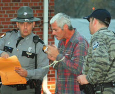 "<div class=""source""></div><div class=""image-desc"">Kentucky State Trooper David Norris begins the paperwork on the arrest of Rodney J. Hall as part of a major police round-up. Hall is charged with three counts of trafficking in marijuana. </div><div class=""buy-pic""><a href=""/photo_select/1659"">Buy this photo</a></div>"