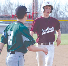"""<div class=""""source""""></div><div class=""""image-desc"""">Tanner Smith strolls into third base.</div><div class=""""buy-pic""""><a href=""""/photo_select/9277"""">Buy this photo</a></div>"""