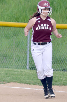 "<div class=""source""></div><div class=""image-desc"">Katie Bihl leads off first against Carroll County. </div><div class=""buy-pic""><a href=""http://web2.lcni5.com/cgi-bin/c2newbuyphoto.cgi?pub=033&orig=CSC_0906.jpg"" target=""_new"">Buy this photo</a></div>"