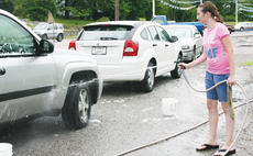 "<div class=""source""></div><div class=""image-desc"">Marissa Craig sprays down one of the cars. </div><div class=""buy-pic""><a href=""/photo_select/9676"">Buy this photo</a></div>"