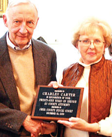 """<div class=""""source"""">Molly Haines</div><div class=""""image-desc"""">Retiring Owen County Attorney Charles Carter was given a plaque for his 25 years of service. Owen County Judge-executive Carolyn Keith was joined by current magistrates Jerry Jones, Bobby Gaines, Teresa Davis and Ray Smith in presenting the plaque to Carter.</div><div class=""""buy-pic""""><a href=""""/photo_select/3805"""">Buy this photo</a></div>"""