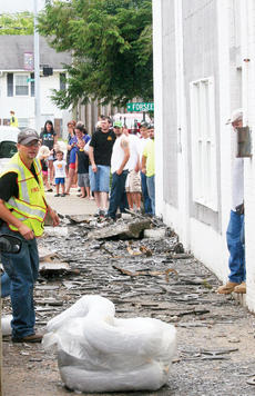 "<div class=""source"">Photo by Molly Haines</div><div class=""image-desc"">Owen County Fire Chief Robb Chaney looks over the mess left on the sidewalk from Friday's crash as crowds gather to watch.</div><div class=""buy-pic""><a href=""http://web2.lcni5.com/cgi-bin/c2newbuyphoto.cgi?pub=033&orig=Crash1.jpg"" target=""_new"">Buy this photo</a></div>"