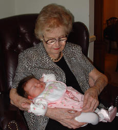 "<div class=""source"">Ernie Stamper</div><div class=""image-desc"">Mother holding g-granddaughter Annelise, Nov 4, 2006. We would lose Mother on Dec 29. </div><div class=""buy-pic""></div>"