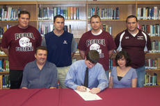 """<div class=""""source""""></div><div class=""""image-desc"""">As his family and coaching staff look on, Owen County High School's Daniel Dauwe, front row, center, formally signs his letter of intent to attend the University of the Cumberlands in Williamsburg.</div><div class=""""buy-pic""""><a href=""""http://web2.lcni5.com/cgi-bin/c2newbuyphoto.cgi?pub=033&orig=Daniel.jpg"""" target=""""_new"""">Buy this photo</a></div>"""