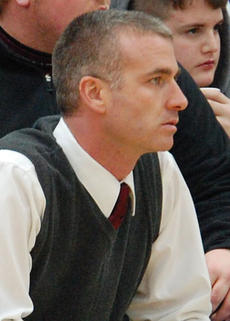 "<div class=""source"">Brian Blair</div><div class=""image-desc"">Owen County Boys Basketball Head Coach Devin Duvall looks on during the Gallatin County game last week.</div><div class=""buy-pic""><a href=""http://web2.lcni5.com/cgi-bin/c2newbuyphoto.cgi?pub=033&orig=Devin-Duvall.jpg"" target=""_new"">Buy this photo</a></div>"