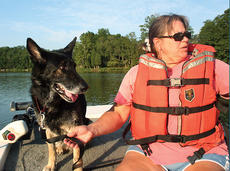 """<div class=""""source"""">John Whitlock</div><div class=""""image-desc"""">Grand Paws Search Dog Association President Patty Petzinger takes her dog, Rosa, out on the water of Elmer Davis Lake as part of a training exercise involving a potential drowning. </div><div class=""""buy-pic""""><a href=""""/photo_select/5629"""">Buy this photo</a></div>"""