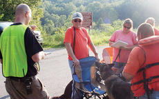 """<div class=""""source""""></div><div class=""""image-desc"""">Members of Grand Paws Search Dog Association listen to a training scenario in which a young boy is missing at Elmer Davis Lake.</div><div class=""""buy-pic""""><a href=""""/photo_select/5631"""">Buy this photo</a></div>"""