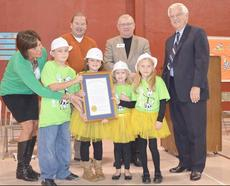"""<div class=""""source"""">Photo courtesy of Whitney Duvall /Owen Electric</div><div class=""""image-desc"""">Owen Primary School Principal Sharen Hubbard, left, and students welcomed Owen County Board of Education Chairman Stuart Bowling, interim superintendent Sonny Fentress and other dignitaries for the presentation of the Energy Star designation at the school.</div><div class=""""buy-pic""""><a href=""""/photo_select/8415"""">Buy this photo</a></div>"""