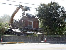"<div class=""source"">Nicole Guest</div><div class=""image-desc"">Workers demolished a 116-year-old house at 205 N. Main St. that was listed in 1984 by the National Register of Historic Places. Church officials say it deteriorated beyond repair. Grass seed has been sewn on the lot.  </div><div class=""buy-pic""><a href=""/photo_select/2604"">Buy this photo</a></div>"