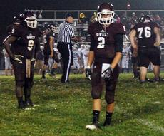 """<div class=""""source"""">Brian Blair</div><div class=""""image-desc"""">Collin Trammell and Chris Smith look to the sidelines for instruction while playing defense.</div><div class=""""buy-pic""""><a href=""""http://web2.lcni5.com/cgi-bin/c2newbuyphoto.cgi?pub=033&orig=FOOTBALL-1126.jpg"""" target=""""_new"""">Buy this photo</a></div>"""