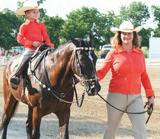 """<div class=""""source""""></div><div class=""""image-desc"""">Samuel Cobb rides around the track during the lead line class of Monday's open horse show</div><div class=""""buy-pic""""><a href=""""/photo_select/7621"""">Buy this photo</a></div>"""