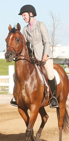"""<div class=""""source"""">Photo by Molly Haines</div><div class=""""image-desc"""">Along with pageants and rides, the open horse show also took place Monday.</div><div class=""""buy-pic""""><a href=""""http://web2.lcni5.com/cgi-bin/c2newbuyphoto.cgi?pub=033&orig=Fair3_1.jpg"""" target=""""_new"""">Buy this photo</a></div>"""