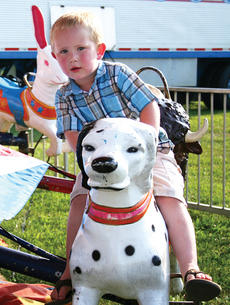 """<div class=""""source"""">Molly Haines</div><div class=""""image-desc"""">Timmy Byrd Jr. enjoys one of this year's many rides on the midway</div><div class=""""buy-pic""""><a href=""""http://web2.lcni5.com/cgi-bin/c2newbuyphoto.cgi?pub=033&orig=Fair4.jpg"""" target=""""_new"""">Buy this photo</a></div>"""