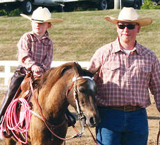 """<div class=""""source"""">Photo by Molly Haines</div><div class=""""image-desc"""">Audrey Roberts, along with her dad Brent Roberts, looks to the crowd during the open horse show</div><div class=""""buy-pic""""><a href=""""/photo_select/7619"""">Buy this photo</a></div>"""