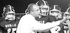 "<div class=""source"">News-Herald File Photo</div><div class=""image-desc""> Owen County High School Head Football Coach Adam Fowler gives his players instruction during a game last season. The year's team opens the season on the road against Western Hills in Frankfort.   </div><div class=""buy-pic""><a href=""/photo_select/10272"">Buy this photo</a></div>"