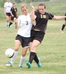 """<div class=""""source"""">Brian Blair</div><div class=""""image-desc"""">Amber Gover fights for an advantage over a Carroll County player  in the All A Classic Championship game on Saturday in Owenton</div><div class=""""buy-pic""""><a href=""""http://web2.lcni5.com/cgi-bin/c2newbuyphoto.cgi?pub=033&orig=Girls-Soccer-12-022.jpg"""" target=""""_new"""">Buy this photo</a></div>"""