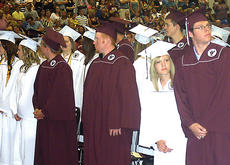 """<div class=""""source"""">John Whitlock</div><div class=""""image-desc"""">The Owen County High School Class of 2011 files into the school gym for commencement. </div><div class=""""buy-pic""""><a href=""""/photo_select/5141"""">Buy this photo</a></div>"""