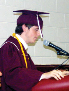 """<div class=""""source"""">John Whitlock</div><div class=""""image-desc"""">Class president Gray Grisham welcomes students, family and friends to the 2011 commencement.</div><div class=""""buy-pic""""><a href=""""/photo_select/5142"""">Buy this photo</a></div>"""