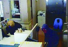 """<div class=""""source""""></div><div class=""""image-desc"""">Police are on the lookout for these two heavily disguised men in connection with the First Farmers Bank location in Gratz.</div><div class=""""buy-pic""""><a href=""""/photo_select/116"""">Buy this photo</a></div>"""