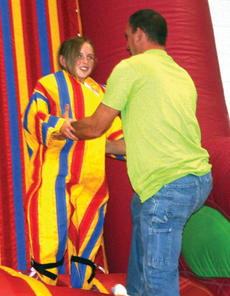 """<div class=""""source"""">Molly Haines</div><div class=""""image-desc"""">A Velcro wall was one of the special attractions at the first God Gives Hope to Owen County event held this weekend.</div><div class=""""buy-pic""""><a href=""""/photo_select/143"""">Buy this photo</a></div>"""