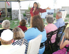 "<div class=""source"">Molly Haines</div><div class=""image-desc"">Storyteller Bonnie Strassell shares one of her stories with those attending the history and dedication day Saturday.