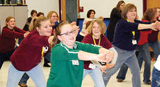 """<div class=""""source""""></div><div class=""""image-desc"""">One of the favorite workshops of last year's conference was Zumba. Above, participants try out the workshop, which is designed for all ages. The session will be offered twice at this year's conference, which is scheduled for March.</div><div class=""""buy-pic""""><a href=""""/photo_select/3177"""">Buy this photo</a></div>"""