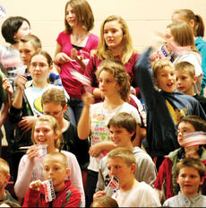 """<div class=""""source""""></div><div class=""""image-desc"""">MBMS students wave """"God Bless America"""" flags and chant """"U.S.A."""" while Veterans made their entrance into the MBMS gymnasium.</div><div class=""""buy-pic""""><a href=""""/photo_select/8433"""">Buy this photo</a></div>"""