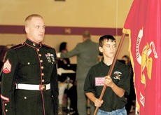 """<div class=""""source""""></div><div class=""""image-desc"""">Sgt. Lance Harvey, a United States Marine, stands with MBMS student Josh Spaulding while marines were honored during Monday's program. </div><div class=""""buy-pic""""><a href=""""/photo_select/8432"""">Buy this photo</a></div>"""