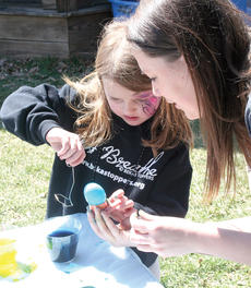 "<div class=""source"">John Whitlock </div><div class=""image-desc"">Adi Bowling, left, gets some help coloring eggs from Kaylan Richardson.</div><div class=""buy-pic""><a href=""http://web2.lcni5.com/cgi-bin/c2newbuyphoto.cgi?pub=033&orig=IMG_8444.jpg"" target=""_new"">Buy this photo</a></div>"