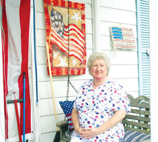 """<div class=""""source"""">Photo by Molly Haines  </div><div class=""""image-desc"""">Local dentist Dr. Joy Arnold-Morse relaxes on her front porch among her red, white and blue collection.</div><div class=""""buy-pic""""><a href=""""/photo_select/9926"""">Buy this photo</a></div>"""