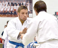 """<div class=""""source"""">Brian Blair</div><div class=""""image-desc"""">James Thompson sizes up an opponent during the competition Saturday. The Owen County Judo Team took first place in the tournament. </div><div class=""""buy-pic""""><a href=""""http://web2.lcni5.com/cgi-bin/c2newbuyphoto.cgi?pub=033&orig=JUDO-0293.jpg"""" target=""""_new"""">Buy this photo</a></div>"""