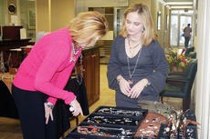 "<div class=""source"">Molly Haines</div><div class=""image-desc"">Ashley Griffin, right, an Owen County native, set up shop Friday at Peoples Bank with Scentsy candle products and Silpada Jewelry as a fund-raiser for Relay For Life. Here Griffin shows off a few of her jewelry items to Rhonda Doris.</div><div class=""buy-pic""><a href=""http://web2.lcni5.com/cgi-bin/c2newbuyphoto.cgi?pub=033&orig=Jewelry.jpg"" target=""_new"">Buy this photo</a></div>"