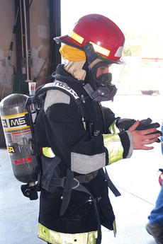 """<div class=""""source""""></div><div class=""""image-desc"""">Junior firefighter Kevin Ingram stands fully-equipped in his firefighting gear.</div><div class=""""buy-pic""""><a href=""""/photo_select/5701"""">Buy this photo</a></div>"""