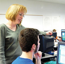 """<div class=""""source""""></div><div class=""""image-desc"""">Owen County High School teacher Kay Bush helps a student. Bush was recently named technology teacher of the year.</div><div class=""""buy-pic""""><a href=""""/photo_select/3396"""">Buy this photo</a></div>"""