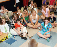 """<div class=""""source"""">John Whitlock</div><div class=""""image-desc"""">Guests at this year's Owen County Public Library Summer Reading Program finale reacted in different ways to Mirrhi, a young red Kangaroo from Kentucky Down Under.</div><div class=""""buy-pic""""><a href=""""/photo_select/5330"""">Buy this photo</a></div>"""