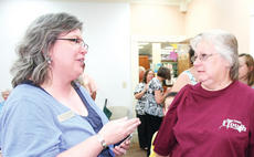 """<div class=""""source""""></div><div class=""""image-desc"""">Owen County Public Library Director Jennifer Nippert discusses the library's future with Marsha Derringer. </div><div class=""""buy-pic""""><a href=""""http://web2.lcni5.com/cgi-bin/c2newbuyphoto.cgi?pub=033&orig=Library3.jpg"""" target=""""_new"""">Buy this photo</a></div>"""
