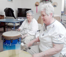 """<div class=""""source""""></div><div class=""""image-desc"""">Linda Oliver and Frances Grisham find their rhythm on the drums during the weekly class.</div><div class=""""buy-pic""""><a href=""""/photo_select/9969"""">Buy this photo</a></div>"""