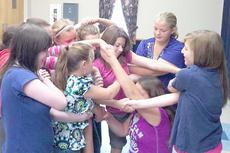 """<div class=""""source""""></div><div class=""""image-desc"""">Students participate in a team-building activity called the """"human knot."""" </div><div class=""""buy-pic""""><a href=""""http://web2.lcni5.com/cgi-bin/c2newbuyphoto.cgi?pub=033&orig=MBMS-4-H-Leadership-Academy-1.jpg"""" target=""""_new"""">Buy this photo</a></div>"""
