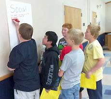 """<div class=""""source""""></div><div class=""""image-desc"""">Students discuss what it means to be a social leader.</div><div class=""""buy-pic""""><a href=""""http://web2.lcni5.com/cgi-bin/c2newbuyphoto.cgi?pub=033&orig=MBMS-4-H-Leadership-Academy-2.jpg"""" target=""""_new"""">Buy this photo</a></div>"""