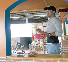 """<div class=""""source""""></div><div class=""""image-desc"""">Fernando Chavez, right, shares as joke with his brother, Mario, as they paint the interior of the former Dairy Queen location in Owenton.  </div><div class=""""buy-pic""""><a href=""""/photo_select/9294"""">Buy this photo</a></div>"""