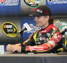 "<div class=""source"">Photos by Will Hearne</div><div class=""image-desc"">Jeff Gordon takes questions in the media center. </div><div class=""buy-pic""><a href=""/photo_select/9882"">Buy this photo</a></div>"
