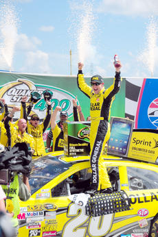 "<div class=""source"">Photo by David Clark</div><div class=""image-desc"">Matt Kenseth, driver of the Joe Gibbs Racing No. 20 Dollar General Toyota, celebrates in Gatorade Victory Lane following his victory in the NASCAR Sprint Cup Series ""Quaker State 400"" held at the Kentucky Speedway in Sparta, KY on June 30th.</div><div class=""buy-pic""><a href=""/photo_select/9879"">Buy this photo</a></div>"
