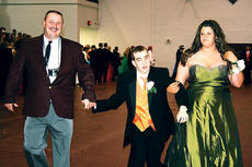 """<div class=""""source""""></div><div class=""""image-desc"""">OCHS teacher Jeff Sutton and Hunter Sutton walk with Dexter Wilson at the grand march. Wilson would be named prom king later that night.  </div><div class=""""buy-pic""""><a href=""""/photo_select/4824"""">Buy this photo</a></div>"""